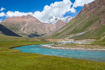 Fototapete - Blue river and snow peaks of Tien Shan mountains