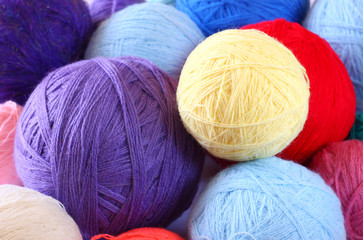 stack of colorful balls of wool