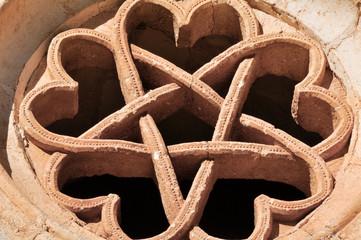 The pentalpha of a rose window, St Bartholomew hermitage, Spain