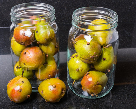 Spiced seckel pears being preserved