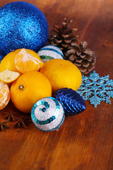 Christmas tangerines and Christmas toys on wooden table