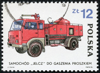 stamp printed in Poland, representing a fire truck