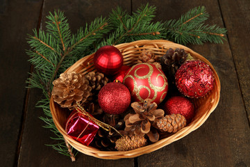 Christmas decorations in basket and spruce branches