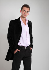Trendy man in black pink and black jacket, portrait of sexy fash