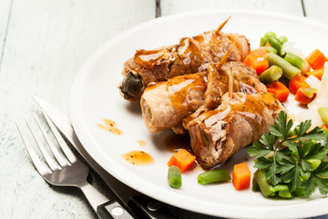 Beef rolls and vegetables