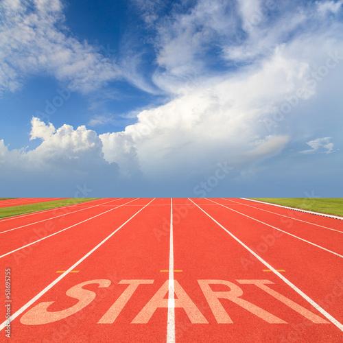 Fototapete Start on running track