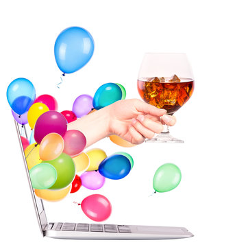hand with whiskey and  laptop