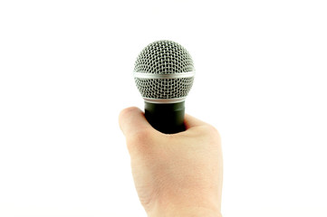 A hand holding a microphone