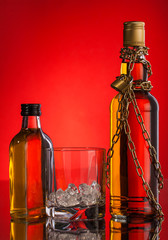 glass and whisky bottles