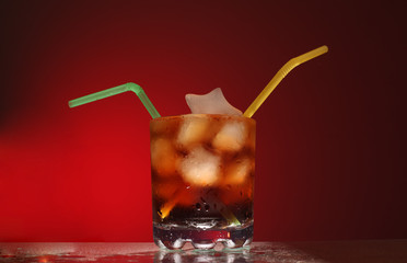 glass transparent glass with ice cubes and cola with