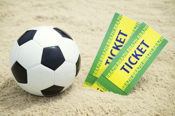 Two Tickets and Football Soccer Ball on Brazilian Beach