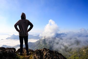 Teenager asian boy standing at mountain