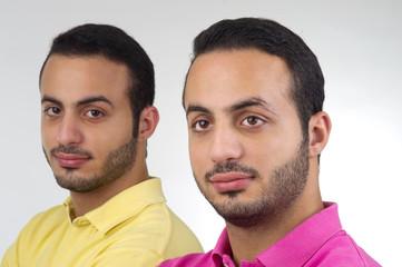 Identical Twins portrait shot against white background