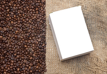 coffee beans on old burlap and blank box for your text