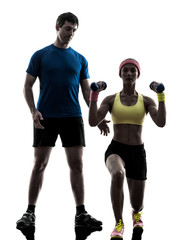 Wall Mural - woman exercising fitness weight training with man coach silhouet