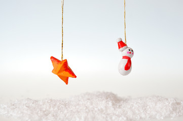Snowman and star on white background
