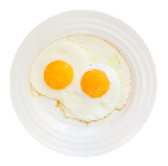 breakfast with two fried eggs in white plate