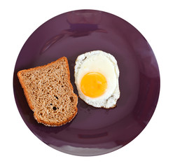 top view of fried egg and toasted rye bread