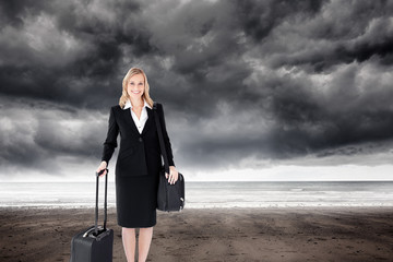 Composite image of smiling businesswoman holding a suitcase