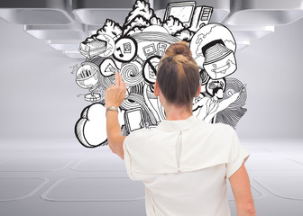 Composite image of businesswoman touching something