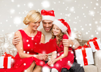 smiling family reading postcard