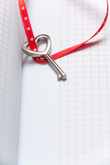 Heart shaped key on notebook