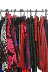 Variety of fashion clothing on hangers