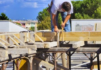 Carpentry work concrete slab structure with motion blur