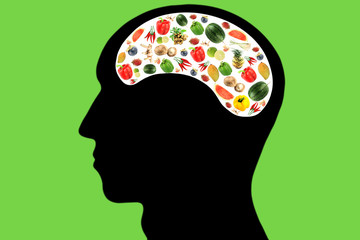 Vegetables and fruits in Head on green Background.