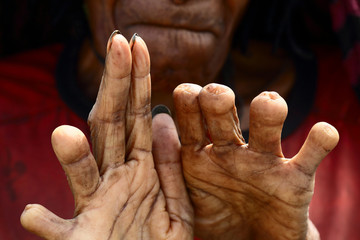 Hands of a woman from Dani tribe. Wamena. Indonesia.