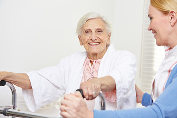 Senior woman with geriatric nurse