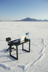 Desk and Empty Office Chair Outdoors White Desert