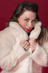 Pinup Girl in White Fur Coat
