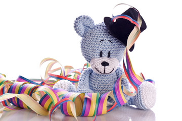 teddy bear with paper streamers and confetti on new years eve