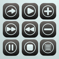 set of buttons in black with white icons on them