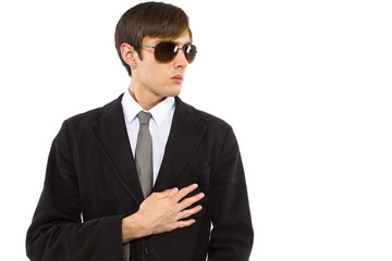 Caucasian male bodyguard wearing sunglasses and black suit