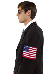 American spy waring a black suit and american flag armband