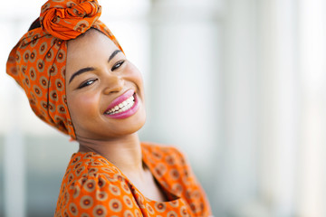 african woman wearing traditional attire Wall mural