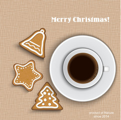 A cup of coffee with gingerbread on canvas background