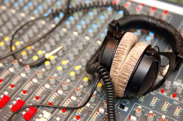 headphones on Audio Mixing Board Sliders in the theatre