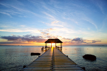 Wall Mural - Jetty silhouette against beautiful sunset in Mauritius Island