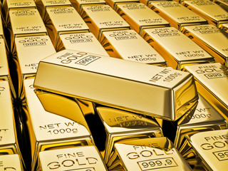 Gold bar on stacks of gold bullions close up