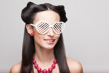 Pin Up model in heart shaped sunglasses