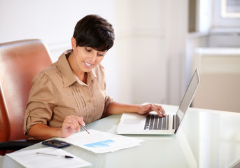 Attractive businesswoman working on her documets