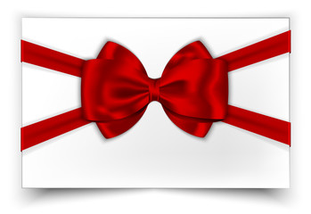 White gift card with red ribbon and bow