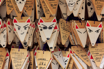Poster Kyoto Fox shaped praying cards at Fushimi Inari shrine in Kyoto