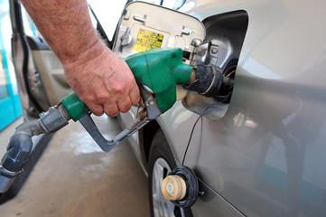 Man fuel his car