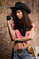 Sheriff woman on wall background