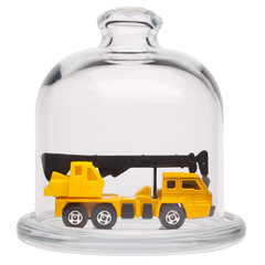 Toy truck crane in a glass dome.