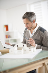 architect working on a model house